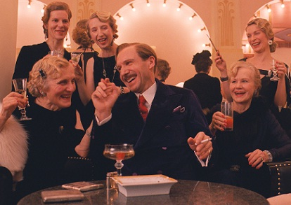 Ralph Fiennes and ladies in The Grand Budapest Hotel